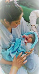 Neelam Chhagani holding daughter first time